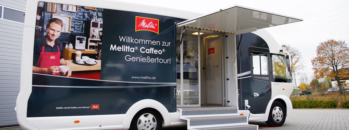 [Translate to English:] Melitta Infomobil Branding Folierung